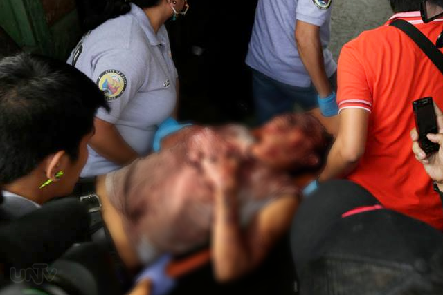 The bloody hostage taker Christopher Magsusay after a seven-hour ordeal with the authorities. The hostage crisis took place at Pasay City, Wednesday February 04, 2015. (PHOTOVILLE International)