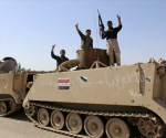 A tank belonging to the Shi'ite Badr Brigade militia takes position in front of a gas station in Suleiman Beg, northern Iraq in this September 9, 2014 file photo. CREDIT: REUTERS/AHMED JADALLAH/FILES