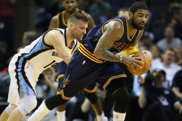 Mar 25, 2015; Memphis, TN, USA; Cleveland Cavaliers forward Kyrie Irving (2) steals the ball from Memphis Grizzlies guard Beno Udrih (19) i the second half at FedExForum. Cleveland defeated Memphis 111-89. Mandatory Credit: Nelson Chenault-USA TODAY Sports