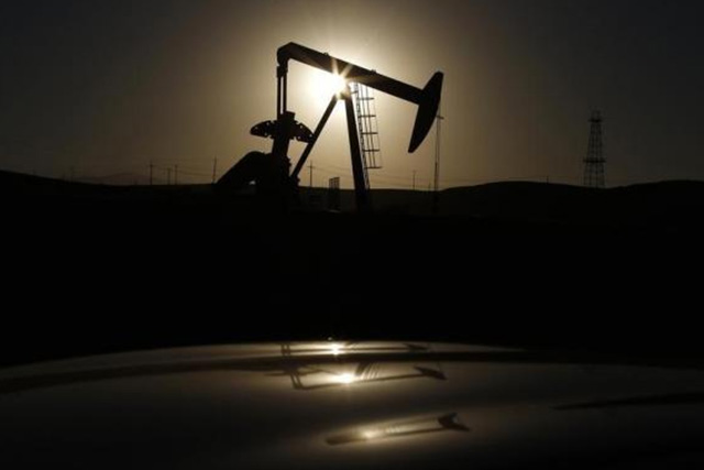 A pump jack is seen at sunrise near Bakersfield, California October 14, 2014. CREDIT: REUTERS/LUCY NICHOLSON