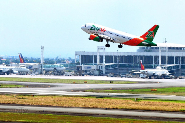 FILE PHOTO: A passenger plane taking off at NAIA Terminal 2 runway. (Ryan Mendoza / Photoville International)