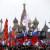 People hold flags and posters during a march to commemorate Kremlin critic Boris Nemtsov, who was shot dead on Friday night, near St. Basil's Cathedral in central Moscow March 1, 2015.  CREDIT: REUTERS/SERGEI KARPUKHIN