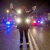 A female protester raises her hands while blocking police cars in Ferguson, Missouri, November 25, 2014. CREDIT: REUTERS/ADREES LATIF