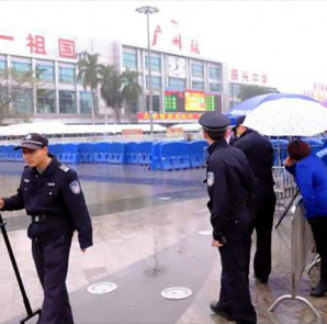 Police control the site after a knife attack outside the Guangzhou Railway Station, Guangdong province, March 6, 2015.  CREDIT: REUTERS/STRINGER