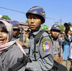 Police attempt to detain a reporter during a student protest against an education bill in Letpadan, Bago division on March 6, 2015.  CREDIT: REUTERS/SOE ZEYA TUN