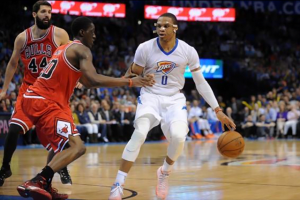 Mar 15, 2015; Oklahoma City, OK, USA; Oklahoma City Thunder guard Russell Westbrook (0) drives to the basket against Chicago Bulls forward Tony Snell (20) during the fourth quarter at Chesapeake Energy Arena. Mandatory Credit: Mark D. Smith-USA TODAY Sports