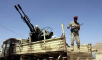 A soldier stands by an anti-aircraft machine gun loaded on a military truck in Yemen's northwestern city of Saada March 31, 2015. REUTERS/NAIYF RAHMA