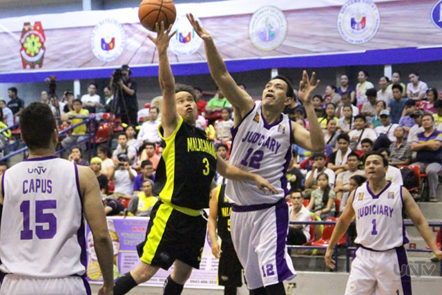 FILE PHOTO: Malacañang Patriots shooting guard TESDA Sec. Joel Villanueva for a lay up in a David and Goliath match up against Judiciary Magis Center Don Camaso. (Lian Opol / Photoville International)