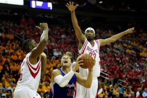 Los Angeles Clippers forward Blake Griffin (32) is defended by Houston Rockets forward Terrence Jones (6) and guard Corey Brewer (33) in the second half in game five of the second round of the NBA Playoffs at Toyota Center. Rockets won 124 to 103. Mandatory Credit: Thomas B....