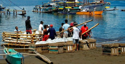 FILE PHOTO: A sunny day at a fishing village in Dalahican, Infanta, Quezon Province (Rogelio Necesito Jr. / Photoville International)