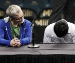 Manny Pacquiao (R) of the Philippines hangs his head as his trainer Freddie Roach looks on during a post-fight news conference after losing to Floyd Mayweather Jr. of the U.S. at the MGM Grand Arena in Las Vegas, Nevada May 2, 2015. REUTERS/RICHARD BRIAN