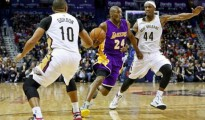 Los Angeles Lakers guard Kobe Bryant (24) drives past New Orleans Pelicans forward Dante Cunningham (44) and guard Eric Gordon (10) during the second quarter of a game at the Smoothie King Center; Jan 21, 2015; New Orleans, LA, USA; Derick E. Hingle-USA TODAY Sports