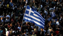 Monday, June 29, 2015 Protesters wave a Greek flag during an anti-austerity rally in Athens, Greece, June 29, 2015. REUTERS/Alkis Konstantinidis
