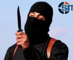 FILE PHOTO: A masked, black-clad militant, who has been identified by the Washington Post newspaper as a Briton named Mohammed Emwazi, brandishes a knife in this still image from a 2014 video obtained from SITE Intel Group February 26, 2015. REUTERS/SITE INTEL GROUP/HANDOUT VIA REUTERS
