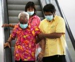 People wearing masks to prevent contracting Middle East Respiratory Syndrome (MERS) ride on an escalator at the Bamrasnaradura Infectious Diseases Institute in Nonthaburi province, on the outskirts of Bangkok, Thailand, June 19, 2015. REUTERS/CHAIWAT SUBPRASOM