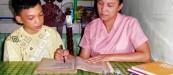 FILE PHOTO: Isang mag-ina na magkasamang nag-aaral o gumagawa ng takdang aralin sa bahay. (Rogz Necessito Jr,  / Photoville International)
