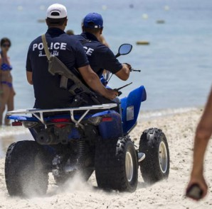 Police officers patrol the beach near the Imperial Marhabada resort, which was attacked by a gunman in Sousse, Tunisia, June 28, 2015. REUTERS/Zohra Bensemra
