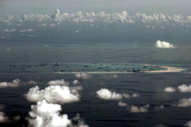 An aerial photo of Spratly Islands in the South China Sea, west of Palawan, Philippines, May 11, 2015. REUTERS/RITCHIE B. TONGO/POOL