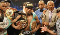 Floyd Mayweather, Jr. of the U.S. poses with his title belts after defeating Manny Pacquiao of the Philippines in their welterweight WBO, WBC and WBA (Super) title fight in Las Vegas, Nevada, May 2, 2015. REUTERS/STEVE MARCUS