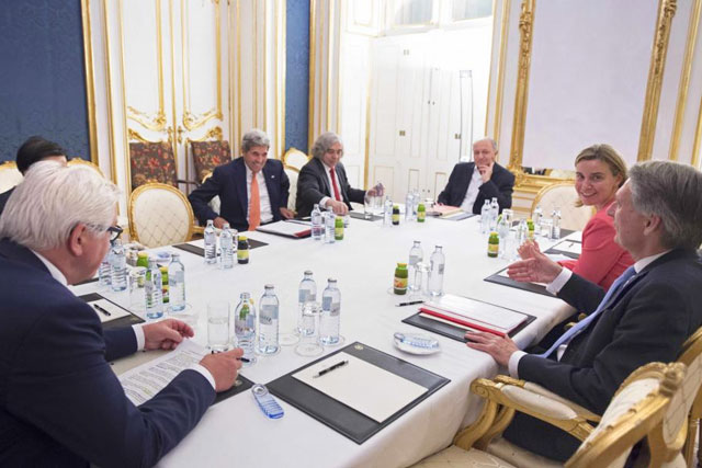 German Foreign Minister Frank-Walter Steinmeier, US Secretary of State John Kerry, US Secretary of Energy Ernest Moniz, French Foreign Minister Laurent Fabius, the High Representative of the European Union for Foreign Affairs and Security Policy Federica Mogherini and British Secretary of State for Foreign and Commonwealth Affairs Philip Hammond (L-R) meet at the Palais Coburg, the venue for nuclear talks in Vienna, Austria July 14, 2015. REUTERS/Joe Klamar/Pool