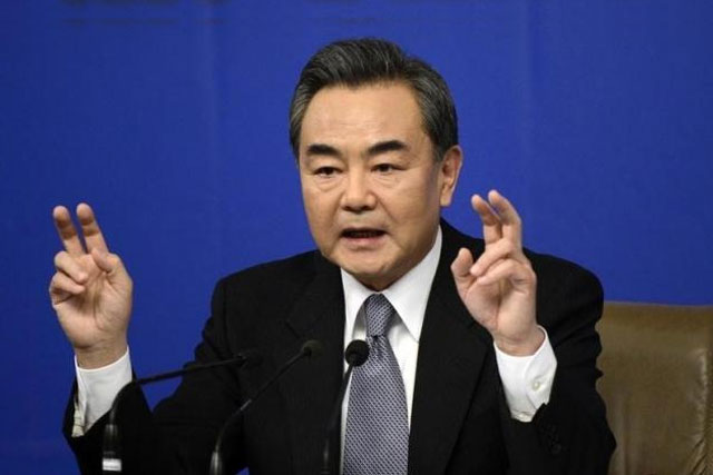 Chinese Foreign Minister Wang Yi gestures as he speaks at a news conference at the annual session of the National People's Congress (NPC), the country's parliament, in Beijing, March 8, 2015. REUTERS/STRINGER
