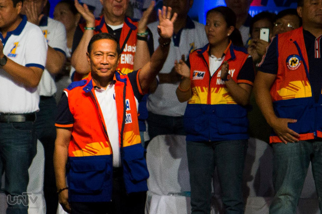 VP Binay waves to supporters during a rally.