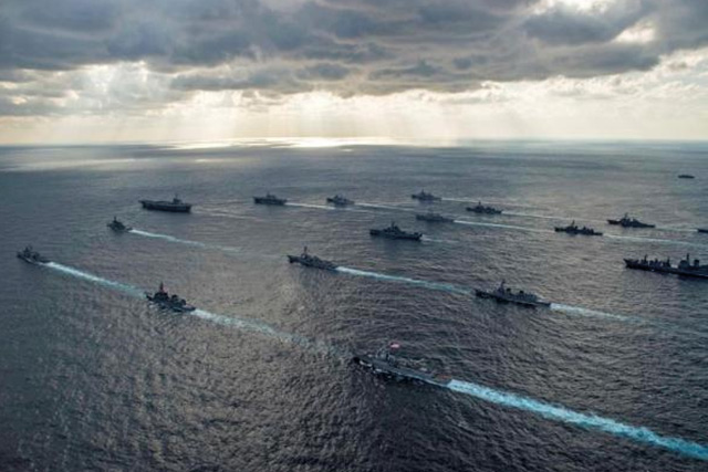FILE PHOTO: U.S. Navy and Japan Maritime Self-Defense Force ships steam in formation during their military manoeuvre exercise known as Keen Sword 15 in the sea south of Japan, in this November 19, 2014 handout provided by the U.S. Navy. REUTERS/MASS COMMUNICATION SPECIALIST 3RD CLASS CHRIS CAVAGNARO/U.S. NAVY/HANDOUT VIA REUTERS