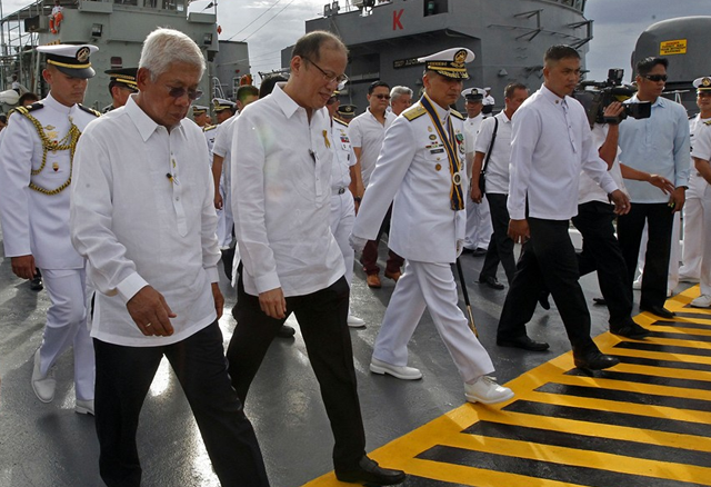 Pres. Aquino marching alongside incoming Navy Flag Officer Rear Admiral Caesar Taccad