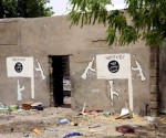 A wall painted by Boko Haram is pictured in Damasak, Nigeria March 24, 2015. REUTERS/JOE PENNEY