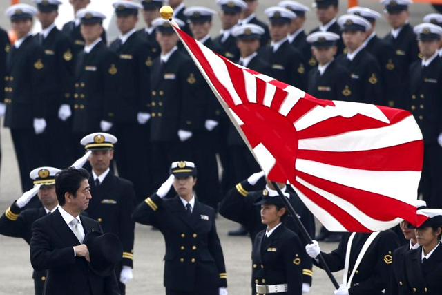 Japan's Prime Minister Shinzo Abe (L) reviews members of Japan Self-Defense Force (JSDF) during the JSDF Air Review, to celebrate 60 years since the service's founding, at Hyakuri air base in Omitama, northeast of Tokyo, in this October 26, 2014 file photo. REUTERS/Toru Hanai/Files