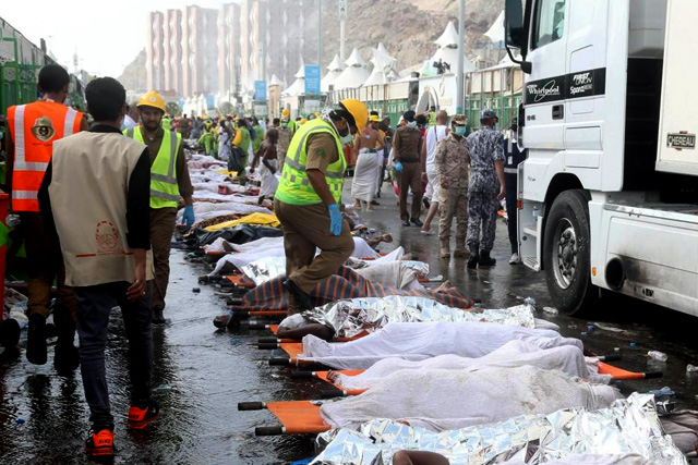 The bodies of Muslim pilgrims are laid on stretchers after a stampede at Mina, outside the holy Muslim city of Mecca September 24, 2015. REUTERS/Stringer