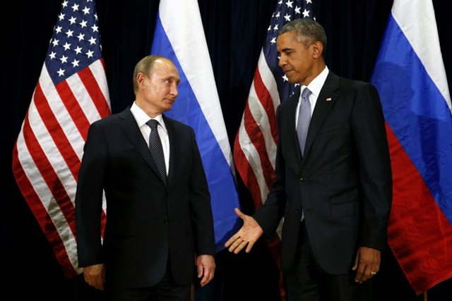 U.S. President Barack Obama extends his hand to Russian President Vladimir Putin during their meeting at the United Nations General Assembly in New York September 28, 2015. REUTERS/Kevin Lamarque