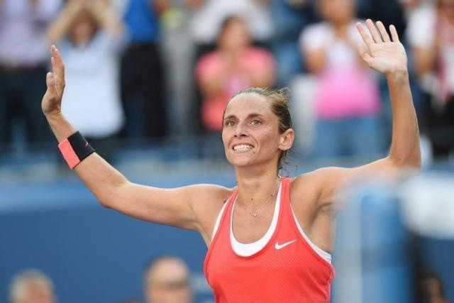 Roberta Vinci of Italy reacts after beating Serena Williams of the USA on day twelve of the 2015 U.S. Robert Deutsch-USA TODAY Sports