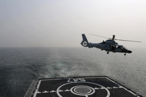 A Chinese naval helicopter takes off from Chinese naval frigate Linyi during multi-country maritime joint exercises off the coast in Qingdao, Shandong province April 23, 2014. REUTERS/CHINA DAILY