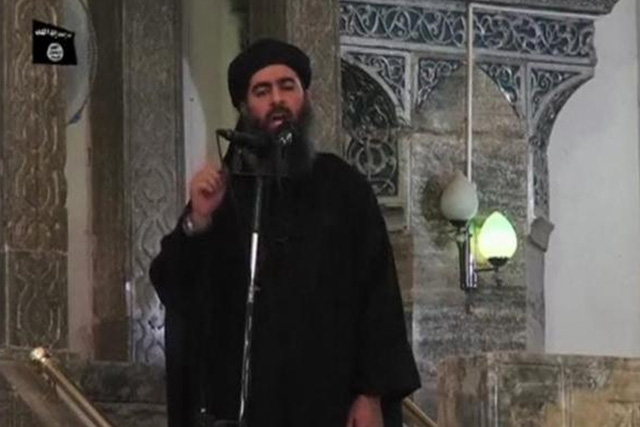 Abu Bakr al-Baghdadi at a mosque in the centre of Iraq's second city, Mosul, according to a video recording posted on the Internet on July 5, 2014, in this still image taken from video. REUTERS/SOCIAL MEDIA WEBSITE VIA REUTERS TV
