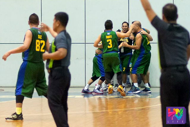 GSIS Furies celebrate after Rene Boy Banzali (#7) sunk a clean 3-point shot to take away the game from DOJ Justice Boosters last Sunday, November   09, 2015 at the Ynares Sports Arena, Pasig City. (MAIA GARCIANO / Photoville International)