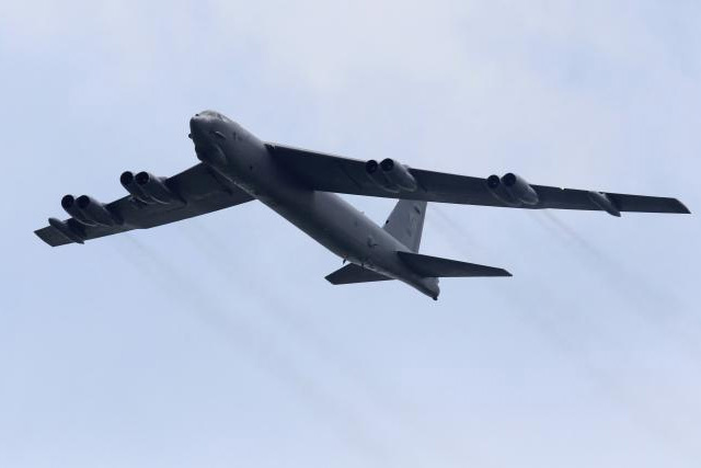 FILE PHOTO: A U.S. Air Force Boeing B-52 Stratofortress strategic bomber from Andersen Air Force Base in Guam performs a fly-over at the Singapore Airshow in Singapore, in this file photo taken February 14, 2012. REUTERS/TIM CHONG/FILES