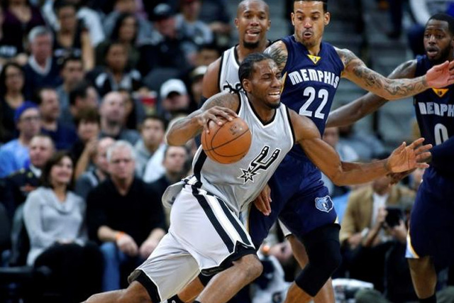 Nov 21, 2015; San Antonio, TX, USA; San Antonio Spurs forward Kawhi Leonard (2) drives against Memphis Grizzlies forward Matt Barnes (22) at the AT&T Center. San Antonio won 92-82. Mandatory Credit: Erich Schlegel-USA TODAY Sports