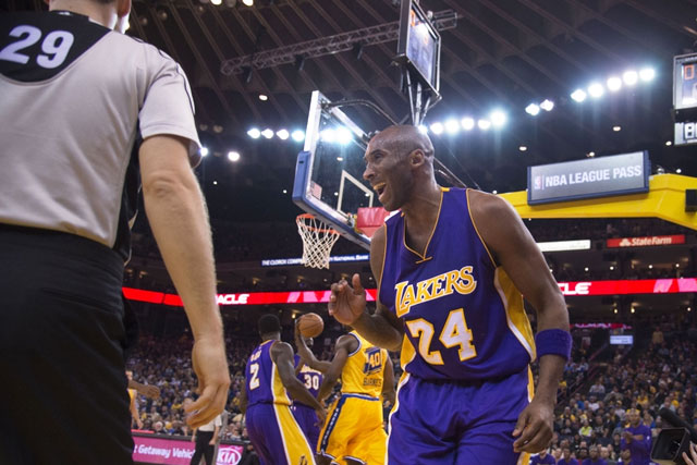 Los Angeles Lakers forward Kobe Bryant (24) reacts to the referee after a play during the second quarter against the Golden State Warriors at Oracle Arena. Mandatory Credit: Kyle Terada-USA TODAY Sports