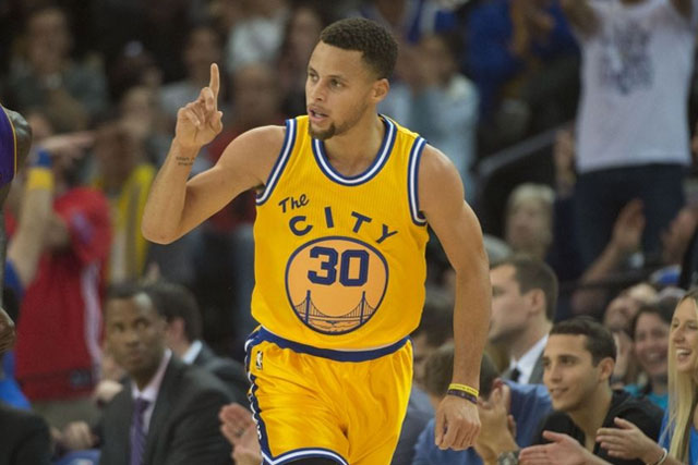 Golden State Warriors guard Stephen Curry (30) celebrates against the Los Angeles Lakers during the first quarter at Oracle Arena. Mandatory Credit: Kyle Terada-USA TODAY Sports