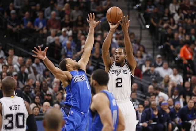 Nov 25, 2015; San Antonio, TX, USA; San Antonio Spurs small forward Kawhi Leonard (2) shoots the ball over Dallas Mavericks shooting guard Justin Anderson (1) during the first half at AT&T Center. Mandatory Credit: Soobum Im-USA TODAY Sports