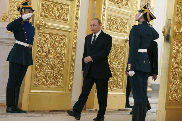 Russia's President Vladimir Putin walks past honor guards as he attends a ceremony to receive diplomatic credentials from foreign ambassadors at the Kremlin in Moscow, Russia, November 26, 2015. REUTERS/Sergei Ilnitsky/Pool