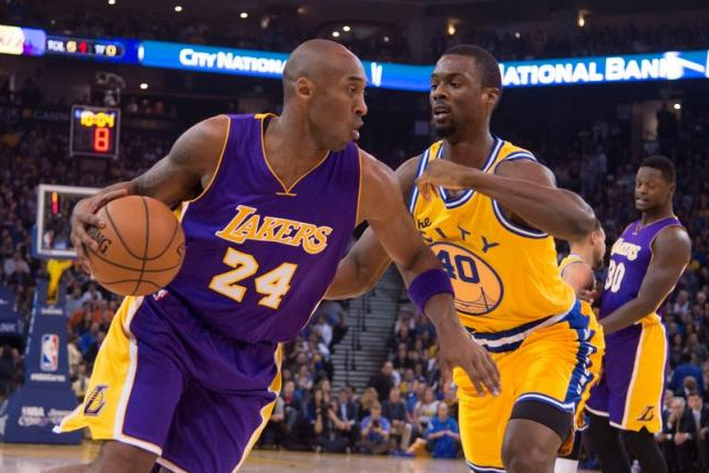 Los Angeles Lakers forward Kobe Bryant (24) dribbles the basketball against Golden State Warriors forward Harrison Barnes (40) during the first quarter at Oracle Arena. Kyle Terada-USA TODAY Sports