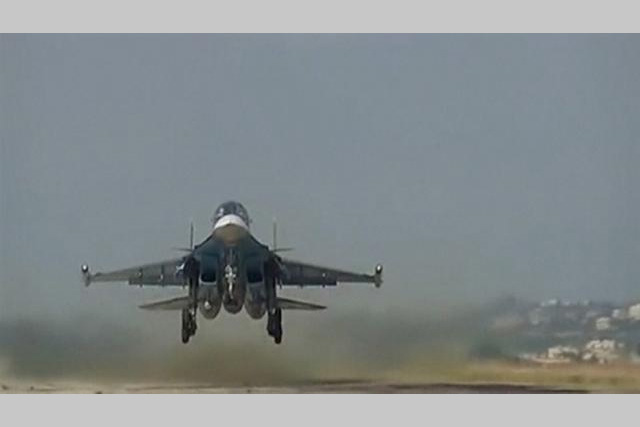 A still image taken from video footage, released by Russia's Defence Ministry on November 19, 2015, shows a Russian military jet taking off at Hmeimim airbase in Syria. REUTERS/MINISTRY OF DEFENCE OF THE RUSSIAN FEDERATION/HANDOUT VIA REUTERS