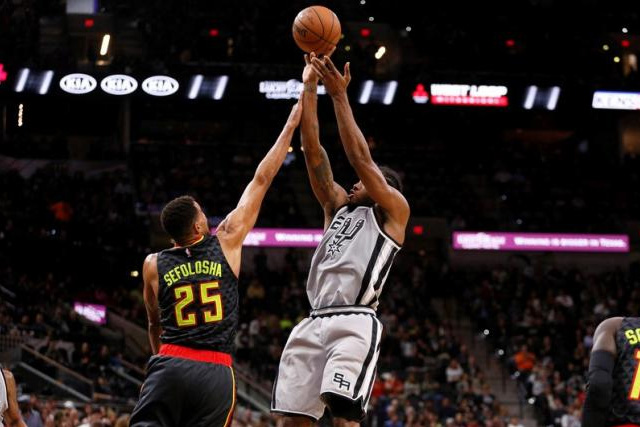 Nov 28, 2015; San Antonio, TX, USA; San Antonio Spurs small forward Kawhi Leonard (2) shoots the ball over Atlanta Hawks shooting guard Thabo Sefolosha (25) during the second half at AT&T Center. Mandatory Credit: Soobum Im-USA TODAY Sports