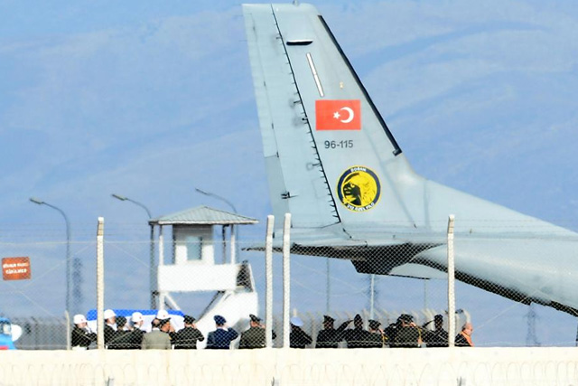 The coffin of the pilot killed when Turkey shot down a Russian jet is carried to a Turkish Air Force Cargo Aircraft, before being handed over to Russia, on the tarmac of the Hatay Airport in Hatay, Turkey, November 29, 2015. REUTERS/Stringer