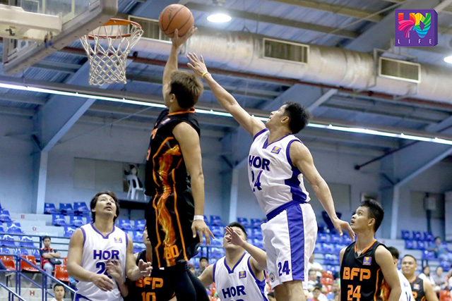 BFP Firefighters Forward Richmond Sibal (L) shoots the ball while HOR Solons Shooting Guard Francis Adriano (R) tries to block during UNTV Cup Season 4 in Ynares Sport Complex Pasig City Philippines on 15 November 2015.  (LIAN OPOL / Photoville International)