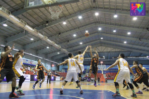 Jay Vincent Gutierrez (#15) of Bureau of Fire Protection pulls a trigger on the free throw line while Rey Malaga Jr. (#29) of Senate Defenders tries to block the shot. (INOH FRANCIS MONTON / Photoville International)