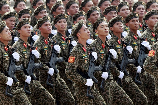 Soldiers hold Israeli-made Galil rifles while marching during a celebration to mark National Day at Ba Dinh square in Hanoi September 2, 2015. Photo taken September 2, 2015. REUTERS/Kham -