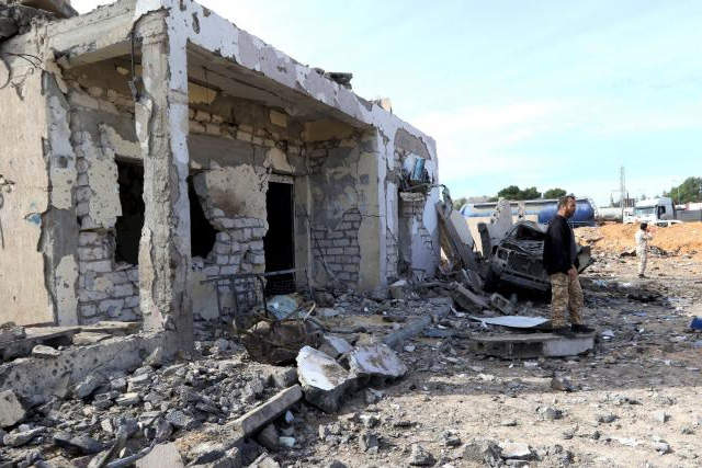 General view of damage at the scene of an explosion at the Mislattah checkpoint near Khoms, on the coast road between Tripoli and Misrata Libya November 24, 2015. REUTERS/STRINGER